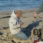 Gearing Up Lures on a Beach