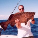Bobby Holding a Grouper