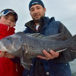 Father and Son with Black Sea Bass