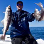 Man Holding 2 Haddock