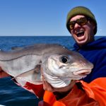 Man Holding His Haddock Catch