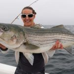 Woman Holding Top-water Striped Bass