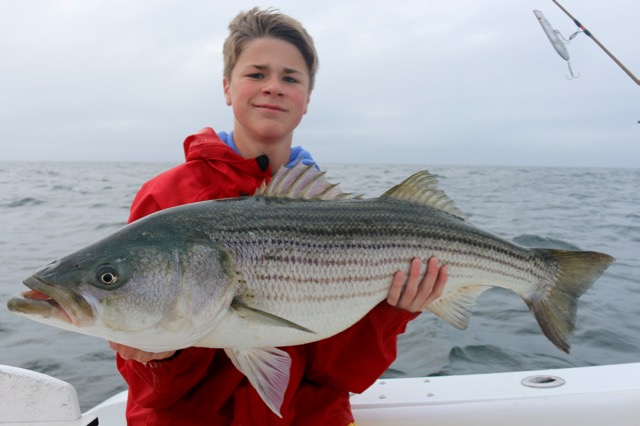 Girl Holding Striped Bass