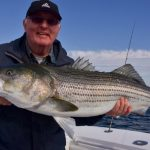 Man with Striped Bass