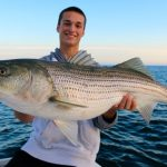 Young Man with Striped Bass