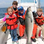 Kids with Striped Bass