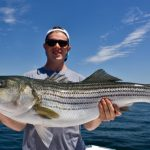 Young Guy with Striped Bass