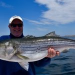 Man Holds Top-water Striped Bass