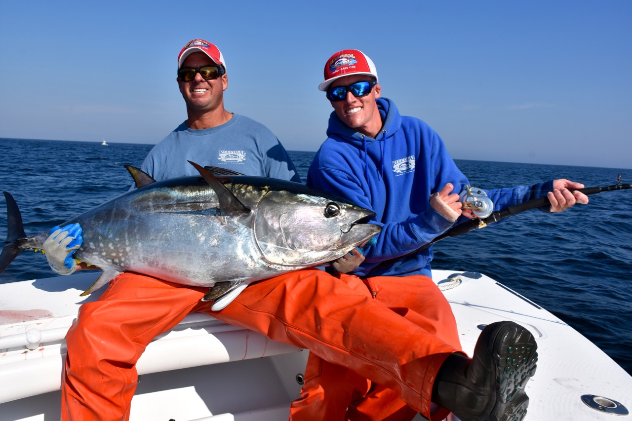 Couple of fishers with bluefin tuna reel deal fishing for Tuna fishing charters
