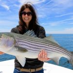 Woman with Truro Striped Bass