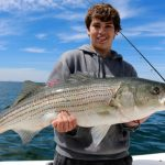 Young Man with Truro Striped Bass