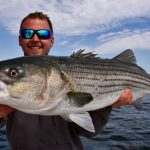 Fisherman with Truro Striped Bass