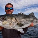Fisherman with Truro Striped Bass