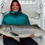 Lady Holding Medium Size Stripe Bass