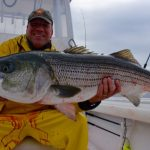 Man with His Striped Bass Catch