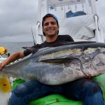Man Holding Large Bluefin Tuna