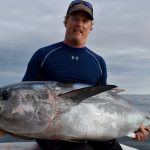 Man Holding Big Tuna
