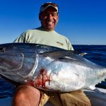 Man Holding Medium Cape Cod Tuna